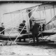 Charlie Taylor and Wilbur Wright attach a canoe onto a new Flyer at Governor's Island New York, October 1909, by George Grantham Bain Collection - Library of Congress Catalog